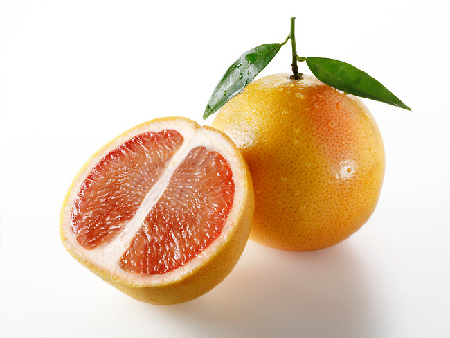 Fresh pink grapefruit with laeves
