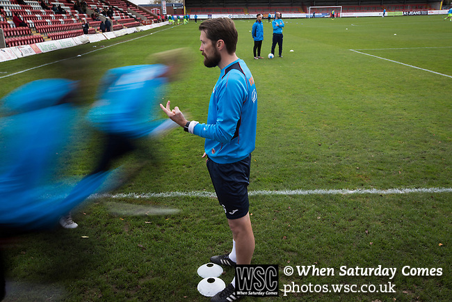 Kidderminster Harriers 3 Gainsborough Trinity 0, 19/11/2016. Aggborough, National League North. The home players going through their pre-match warm up at Aggborough, home of Kidderminster Harriers before they played visitors Gainsborough Trinity in a National League North fixture. Harriers were formed in 1886 and have played at their current home since 1890. They won this match  by 3-0 watched by a crowd of 1465. Photo by Colin McPherson.