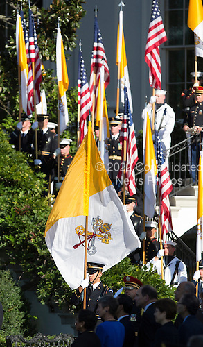 Papal and US flags are displayed as United States President Barack Obama hosts an Official State Welcome ceremony for Pope Francis on the South Lawn of the White House in Washington, DC on Wednesday, September 23, 2015.  <br /> Credit: Chris Kleponis / CNP