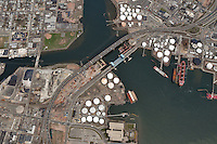 "New Haven Connecticut Harbor, Pearl Harbor Memorial ""Q"" & Tomlinson Bridges just east of Interstate I-95 I-91 US Route 34 Interchanges. Long and High View of approaches, bridges, overpasses, ramps, roadway, Quinnipiac and Mill Rivers, within the I-95 New Haven Harbor Crossing Corridor project confines. Also including Harbor Terminal Operations. Photography taken at the beginning of Construction, Contract B1 & E1"
