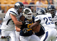 September 1, 2012: California's Keni Kaufusi fighting his way through Nevada's offensive line during a game at Memorial Stadium, Berkeley, Ca   Nevada defeated California 31 - 24