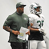 Marcel Shipp, New York Jets running backs coach, left, walks alongside #35 Dominique Williams during team training camp at Atlantic Health Jets Training Center in Florham Park, NJ on Sunday, July 31, 2016.