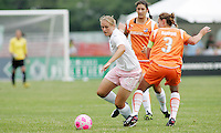 Christie Welsh goes past #3 Christie Rampone..Saint Louis Athletica defeated Sky Blue FC 1-0 at Anheuser-Busch Soccer Park, Fenton, Missouri.