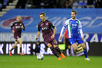 Bersant Celina of Swansea City vies for possession with Nick Powell of Wigan Athletic during the Sky Bet Championship match between Wigan Athletic and Swansea City at the DW Stadium in Wigan, England, UK. Friday 02 October 2018