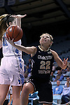22 November 2016: Charleston Southern's Breannah Bretches (22) gets behind North Carolina's Emily Sullivan (11). The University of North Carolina Tar Heels hosted the Charleston Southern University Buccaneers at Carmichael Arena in Chapel Hill, North Carolina in a 2016-17 NCAA Women's Basketball game. UNC won the game 93-77.