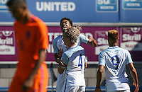 Goalscorer Tom Davies of England celebrates with Chris Willock of England during the International match between England U19 and Netherlands U19 at New Bucks Head, Telford, England on 1 September 2016. Photo by Andy Rowland.