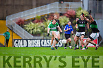 James O'Donoghue Legion takes on Barry O'Driscoll and Kevin Fulignati Nemo Rangers during the AIB Munster club SFC clash in Pairc Uí Rinn on Sunday