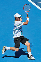 MELBOURNE, 15 JANUARY - Lleyton Hewitt (AUS) hits a forehand in the final of the 2011 AAMI Classic against Gael Monfils (FRA) at Kooyong Tennis Club in Melbourne, Australia. (Photo Sydney Low / syd-low.com)