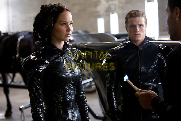 Jennifer Lawrence, Josh Hutcherson, Lenny Kravitz.in The Hunger Games (2012) .*Filmstill - Editorial Use Only*.CAP/NFS.Supplied by Capital Pictures.