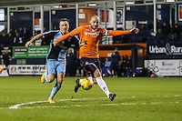 Garry Thompson of Wycombe Wanderers (left) puts Scott Cuthbert of Luton Town (right) during the Sky Bet League 2 match between Luton Town and Wycombe Wanderers at Kenilworth Road, Luton, England on 26 December 2015. Photo by David Horn.