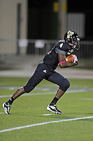 25 October 2011:  FIU wide receiver T.Y. Hilton (4) returns a kickoff in the first quarter as the FIU Golden Panthers defeated the Troy University Trojans, 23-20 in overtime, at FIU Stadium in Miami, Florida.