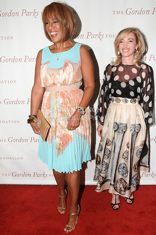 (Left right) journalist Gayle King and Federica Marchionni, President of Dolce & Gabbana USA Inc., arrive at the Gordon Parks Foundation 2014 Award Dinner and Auction on June 3, 2014 at Cipriani Wall Street, located on 55 Wall Street.