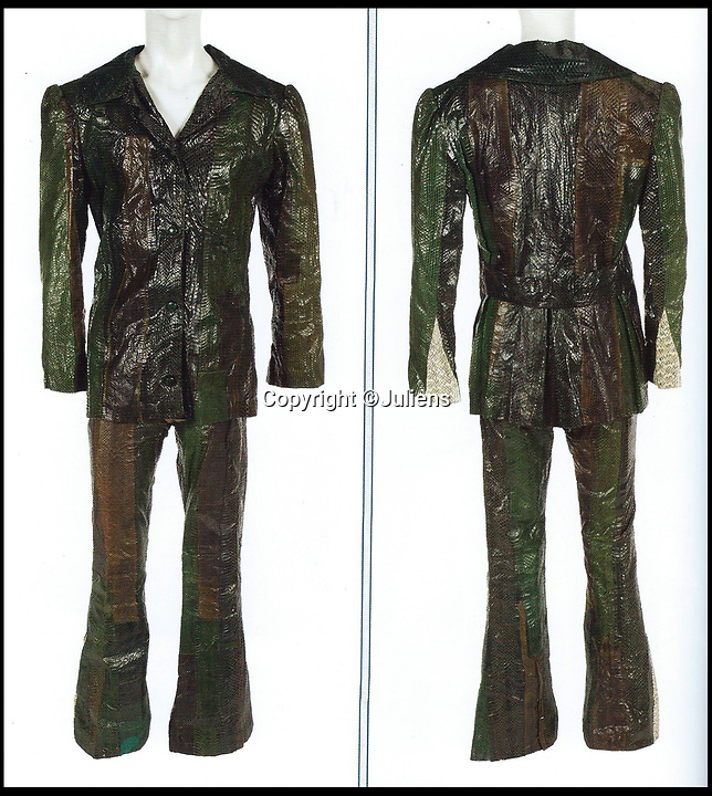 BNPS.co.uk (01202 558833)Pic: Juliens/BNPS<br /> <br /> Mitchell's Hendrix era custom-made snakeskin suit.<br /> <br /> An enormous collection of items belonging to the late drummer Mitch Mitchell has emerged for sale.<br /> <br /> The star, who died at the age of 67 in 2008, was best known for his work with Jimmy Hendrix Experience between 1966 and 1970.<br /> <br /> Now his family have decided to sell a large amount of his personal items as they feel they can no longer handle the responsibility and want to see them go to a good home.<br /> <br /> The collection is made up of countless instruments, shirts, posters and documents - many of which are previously unseen.<br /> <br /> The items offer a gateway to a different time with some incredibly outlandish and psychedelic lots perfectly encapsulating London in the 60s.<br /> <br /> Among them is a multi coloured, patchwork shaggy coat which Mitchell would often wear to parties.<br /> <br /> The coat hangs below the waist and looks more like a rug from Austin Powers front room than a sophisticated dinner jacket.