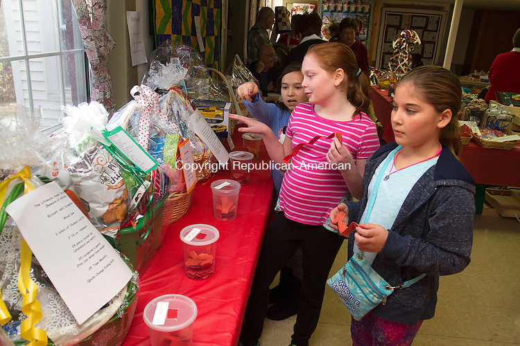 PLYMOUTH, CT - 19 NOVEMBER 2016 - 111916JW06.jpg -- Amanda Parenteau, Hannah Brazee and Samantha Funk discuss their choices of raffle item picks during the First Congregational Church Annual Christmas Bazaar Saturday afternoon.    Jonathan Wilcox Republican-American