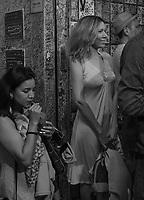 Woman waiting to get in at La Bodeguita del Medio, birthplace of the mojito, La Habana Vieja