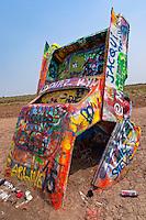 Grafitti covered Cadillac at Cadillac Ranch in Texas.