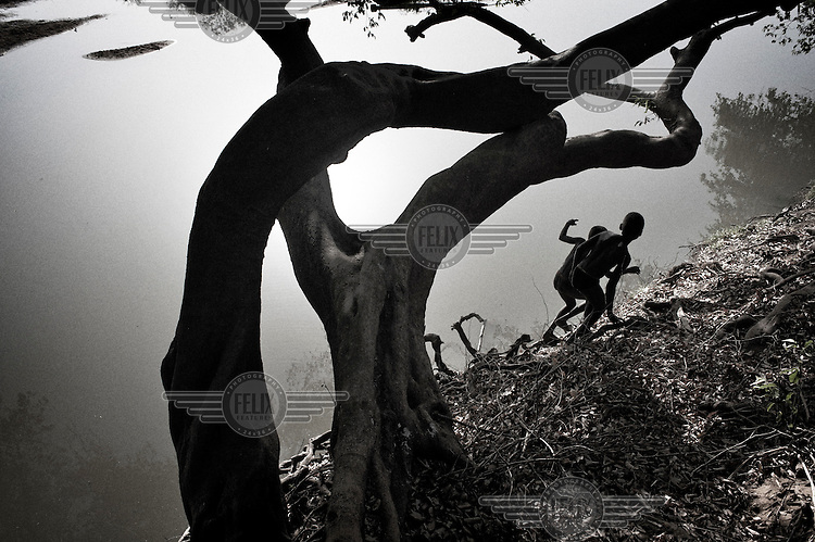South Sudan. 18 March 2011...Children playing on the banks of a tributary of the Nile, near Wau..