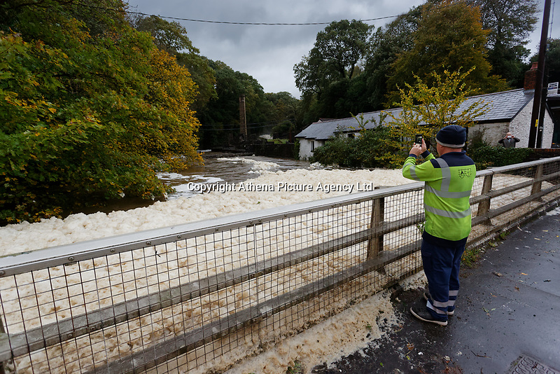 Pictured: Foam caused by the river water is trapped by the fence of Aberdulais Falls in south Wales, UK. Saturday 13 October 2018<br /> Re: Flooding caused by Storm Callum in Aberdulais near Neath, south Wales, UK.