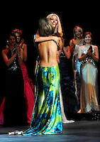 Nicole Blaszczyk (facing), 22, of Novi, Mich., hugs Katie LaRoche, 22, of Bay City, Mich., as she is overcome with excitement after being named Miss Michigan 2009 during the final night of the Miss Michigan Scholarship Pageant held at Frauenthal Theater in Muskegon, Mich., on June 20, 2009.