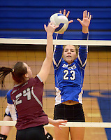 NWA Democrat-Gazette/BEN GOFF @NWABENGOFF<br /> Hannah Lloyd (23) of Rogers jumps to block as Krysten Hall (24) of Siloam Springs spikes the ball on Thursday Aug. 27, 2015 during the match at Rogers High.