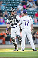 Winston-Salem Dash catcher Sean O'Connell (14) has a meeting with starting pitcher Jordan Stephens (27) during the game against the Frederick Keys at BB&T Ballpark on May 24, 2016 in Winston-Salem, North Carolina.  The Keys defeated the Dash 7-1.  (Brian Westerholt/Four Seam Images)