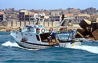- train fishing to the wide of the sicilian southern coast, fishing boat returns in port....- pesca a strascico al largo della costa meridionale siciliana, peschereccio ritorna in porto