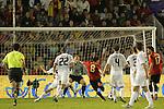 04 June 2008: Xavi (ESP) (8) beats goalkeeper Brad Guzan (USA) (18) for the game's only goal. The Spain Men's National Team defeated the United States Men's National Team 1-0 at Estadio Municipal El Sardinero in Santander, Spain in an international friendly soccer match.