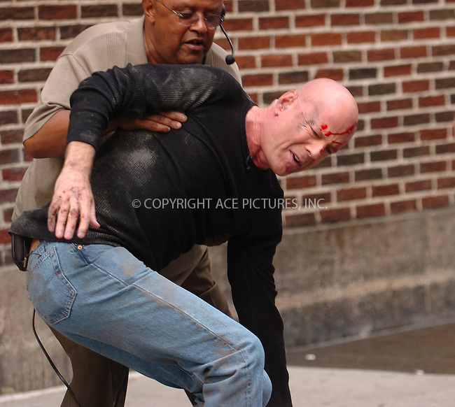 WWW.ACEPIXS.COM . . . . .  ....June 25 2007, New York City....Actor Bruce Willis pretends to fall of the roof of the Ed Sullivan Theatre as a stunt for 'The Late Show with David Letterman' in midtown Manhattan.....Please byline: AJ Sokalner - ACEPIXS.COM..... *** ***..Ace Pictures, Inc:  ..te: (646) 769 0430..e-mail: info@acepixs.com..web: http://www.acepixs.com