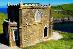 Doyden Castle, Cornwall.<br /> Doyden Castle, situated an hour's walk from Port Quin on a cliff overlooking Lundy Bay, was built in about 1830 by local hedonist Samuel Symons to entertain friends to nights of feasting, drinking and gambling. Today it has been converted into accommodations.