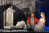 """02/06/2014. London, England. L-R: Nicholas Pallesen as Fieramosca, Michael Spyres as Benvenuto Cellini and Corinne Winters as Teresa. Dress rehearsal of the Hector Berlioz opera """"Benvenuto Cellini"""" at the London Coliseum. Directed by Monty Python and movie director Terry Gilliam for the English National Opera. Benvenuto Cellini opens on 5 June for 8 performances. As part of ENO Screen, the opera will be broadcast live to over 300 cinemas in the UK and Ireland and selected cinemas worldwide on 17 June 2014. Co-production with De Nederlandse Opera, Amsterdam and Teatro dell'Opera di Roma. Michael Spyres as Benvenuto Cellini, Pavlo Hunka as Balducci, Corinne Winters as Teresa, Nicholas Pallesen as Fieramosca and Willard White as Pope Clement VII. Photo credit: Bettina Strenske"""