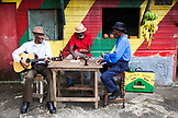 "JAMAICA, Port Antonio. Albert Minott, Joseph ""Powder"" Bennett and Derrick ""Johnny"" Henry of the Mento band, The Jolly Boys playing dominoes at the Willow Wind Bar."