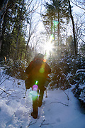 Hiking on Garfield Trail during the winter months. Located in the White Mountains, New Hampshire USA