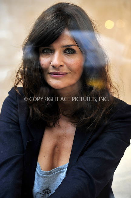 WWW.ACEPIXS.COM . . . . .  ..... . . . . US SALES ONLY . . . . .....October 5 2009, London.... Helena Christensen in the window of the Regent Street Habitat store to promote the new Habitat campaign on October 5 2009 in London....Please byline: FAMOUS-ACE PICTURES... . . . .  ....Ace Pictures, Inc:  ..tel: (212) 243 8787 or (646) 769 0430..e-mail: info@acepixs.com..web: http://www.acepixs.com