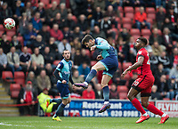 Joe Jacobson of Wycombe Wanderers heads clear of Rowan Liburd of Leyton Orient during the Sky Bet League 2 match between Leyton Orient and Wycombe Wanderers at the Matchroom Stadium, London, England on 1 April 2017. Photo by Andy Rowland.