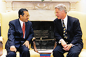 United States President Bill Clinton meets with Prime Minister Bin Mohamad Mahathir of Malaysia in the Oval Office of the White House in Washington, DC on May 21, 1996.<br /> Mandatory Credit:  Ralph Alswang / White House via CNP
