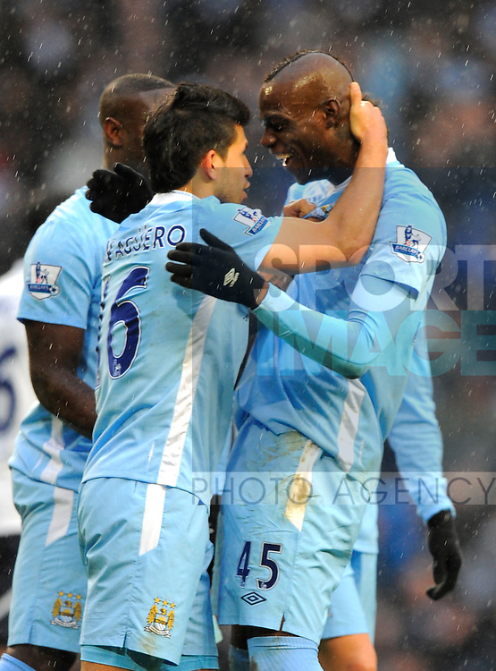 Mario Balotelli of Manchester City celebrates scoring the winning goal with Sergio Aguero of Manchester City.Barclays Premier League.Manchester City v Tottenham at the Eithad Stadium, Manchester 22nd January, 2012..Sportimage +44 7980659747.picturedesk@sportimage.co.uk.http://www.sportimage.co.uk/.Editorial use only. Maximum 45 images during a match. No video emulation or promotion as 'live'. No use in games, competitions, merchandise, betting or single club/player services. No use with unofficial audio, video, data, fixtures or club/league logos.