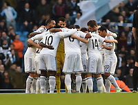 Picture by Howard Roe/AHPIX.com. Football, Barclays Premier League; <br /> Manchester City v Swansea City ;22/11/2014 KO 3.00 pm <br /> Etihad Stadium;<br /> copyright picture;Howard Roe;07973 739229<br /> Swansea's    team huddle