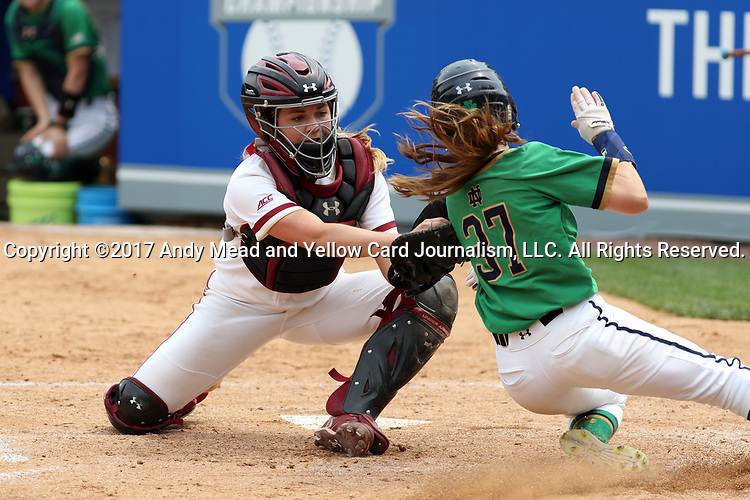 CHAPEL HILL, NC - MAY 11: Notre Dame's Ali Wester (37) is tagged out at home by Boston College's Jordan Chimento (left). The #4 Boston College Eagles played the #5 University of Notre Dame Fighting Irish on May 11, 2017, at Anderson Softball Stadium in Chapel Hill, NC in a 2017 Atlantic Coast Conference Tournament Quarterfinal Softball game. Notre Dame won the game 9-5 in eight innings.