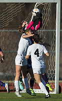 NWA Democrat-Gazette/BEN GOFF @NWABENGOFF<br /> Haley Woodward, Fayetteville goalkeeper, defends as Sara Roberts (14) and Tyler Ann Reash (4) of Bentonville attack  Tuesday, March 13, 2018, during the match at Bentonville's Tiger Athletic Complex.