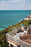 EXUMA, Bahamas. A balcony overlooking the water at Fowl Cay Resort.