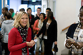Busy staff member, Open Day at Kingston College when prospective students and their parents look around.