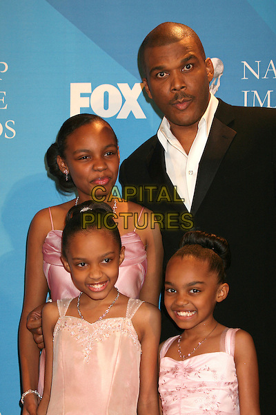 TYLER PERRY, SIERRA AYLINA McCLAIN, LAURYN ALISA McCLAIN.38th Annual NAACP Image Awards at the Shrine Auditorium - Press Room, Los Angeles, California, USA, .2 March 2007..half length.CAP/ADM/BP.©Byron Purvis/AdMedia/Capital Pictures.