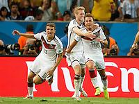 Mario Gotze of Germany celebrates scoring a goal after making it 1-0