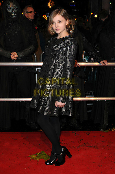 "CHLOE MORETZ .""Harry Potter And The Deathly Hallows: Part 1"" World Film Premiere, Empire cinema Leicester Square and Odeon Leicester Square, London, England, UK, 11th November 2010. .full length black tartan plaid dress tights checked grey gray side .CAP/CAS.©Bob Cass/Capital Pictures."