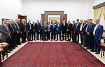 Palestinian President Mahmoud Abbas meets with a delegation of Palestinian businessmen, in the West Bank city of Ramallah on Aug. 05, 2018. Photo by Thaer Ganaim