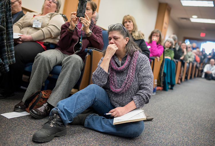 UNITED STATES - MARCH 16: Lillian Potter-Saum listens to Sen. Joe Manchin, D-W.Va., conduct a town hall meeting at the WVU Robert C. Byrd Health Sciences Center in Martinsburg, W.Va., March 16, 2017. Much of the discussion was regarding the American Health Care Act, the Republican's plan to repeal and replace the ACA. (Photo By Tom Williams/CQ Roll Call)