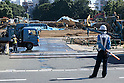 Demolition works continue at the site of the National Stadium built for the Tokyo 1964 Olympic Games on July 21, 2015, Tokyo, Japan. The Japanese Prime Minister Shinzo Abe has announced that the government will review construction plans for a new showcase national stadium for the 2020 Tokyo Olympic Games after growing criticism of the spiraling costs of the first stadium plan designed by Zaha Hadid. The government decided to review the plan because ''many people and athletes strongly criticized it.'' As a result of Abe's decision to go back to the drawing board the new stadium will no longer be completed in time for the 2019 Rugby World Cup. (Photo by Rodrigo Reyes Marin/AFLO)