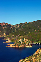 Corsica. Isolated village of Girolata with its Genoese fort guarding the entrance to the bay.  Golfe de Porto..