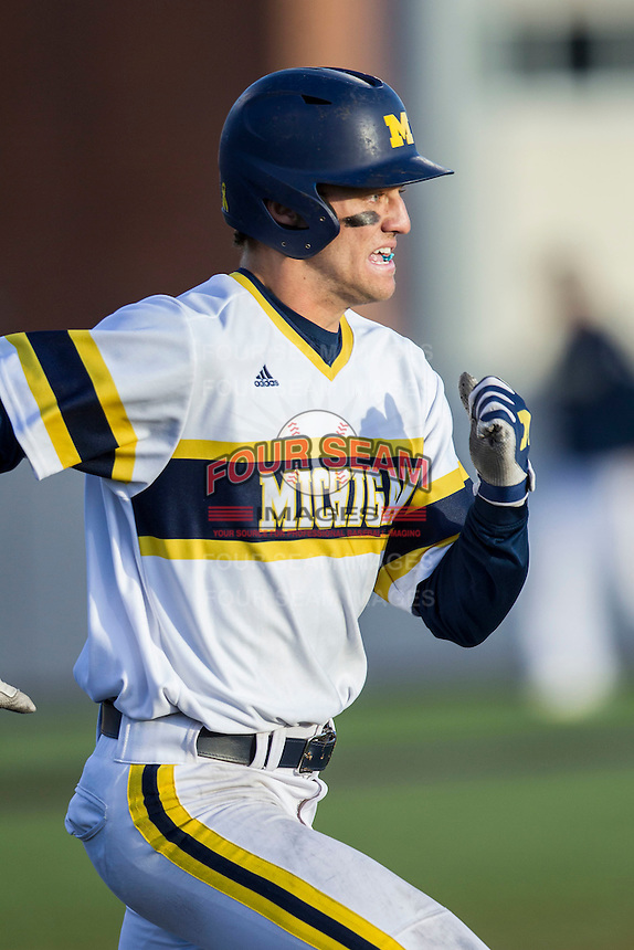 Michigan Wolverines third baseman Jake Bivens (18) runs to first base against the Central Michigan Chippewas on March 29, 2016 at Ray Fisher Stadium in Ann Arbor, Michigan. Michigan defeated Central Michigan 9-7. (Andrew Woolley/Four Seam Images)