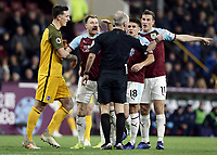 Burnley players remonstrate to Referee Martin Atkinson after Phillip Bardsley went down with an apparent head injury in the penalty area<br /> <br /> Photographer Rich Linley/CameraSport<br /> <br /> The Premier League - Burnley v Brighton and Hove Albion - Saturday 8th December 2018 - Turf Moor - Burnley<br /> <br /> World Copyright © 2018 CameraSport. All rights reserved. 43 Linden Ave. Countesthorpe. Leicester. England. LE8 5PG - Tel: +44 (0) 116 277 4147 - admin@camerasport.com - www.camerasport.com